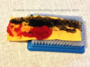 Then, starting with a strip of the black organza down one edge, I started stabbing & building.